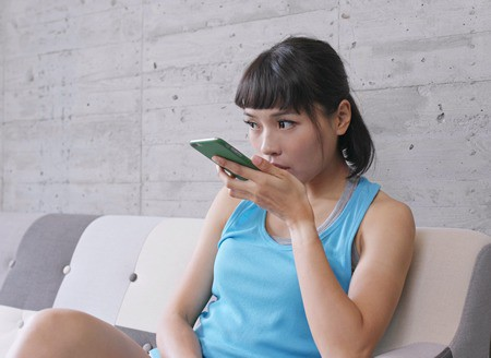 woman talking into phone for internet search